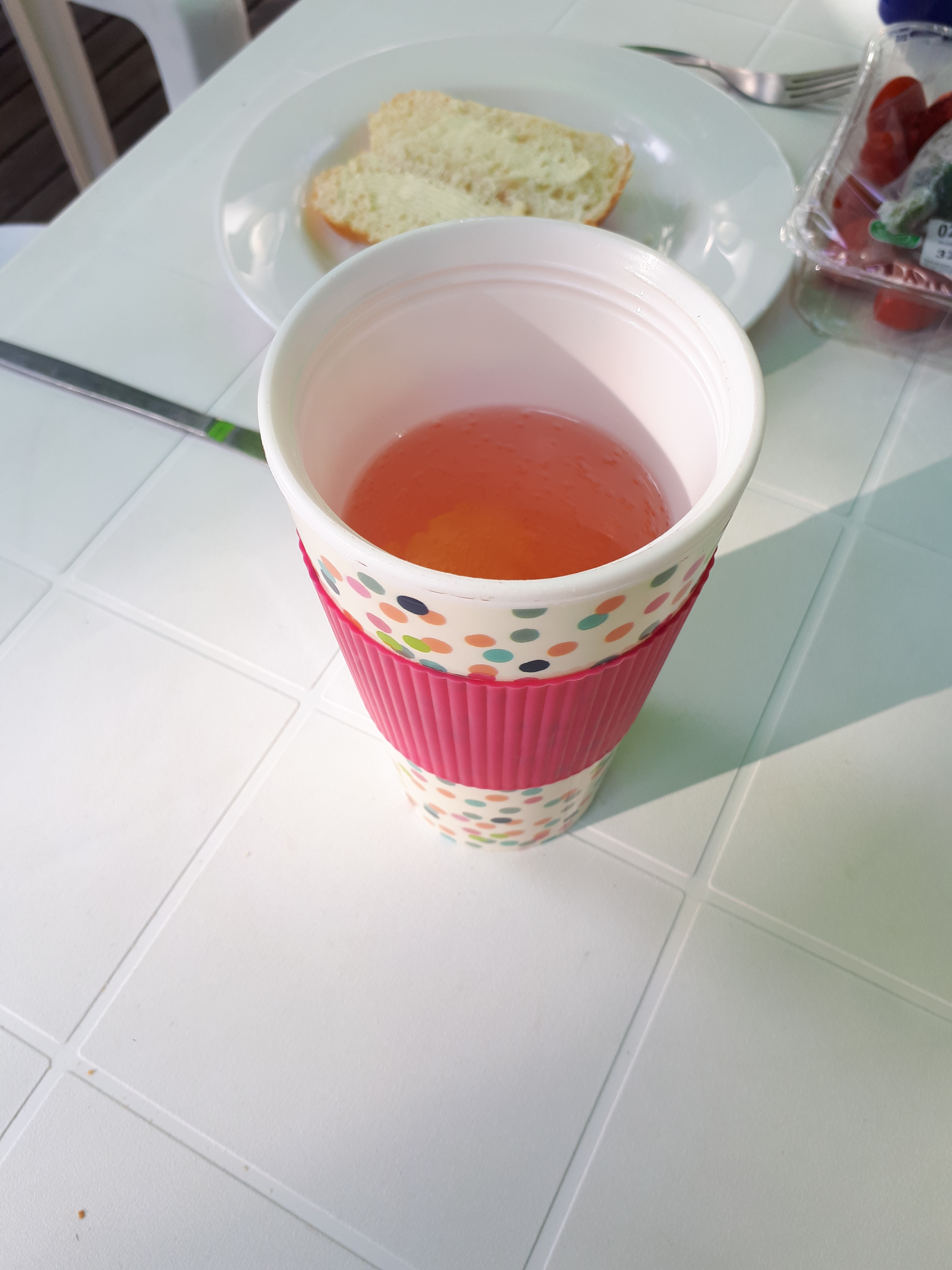 spotty thermal mug with pink wine cocktail