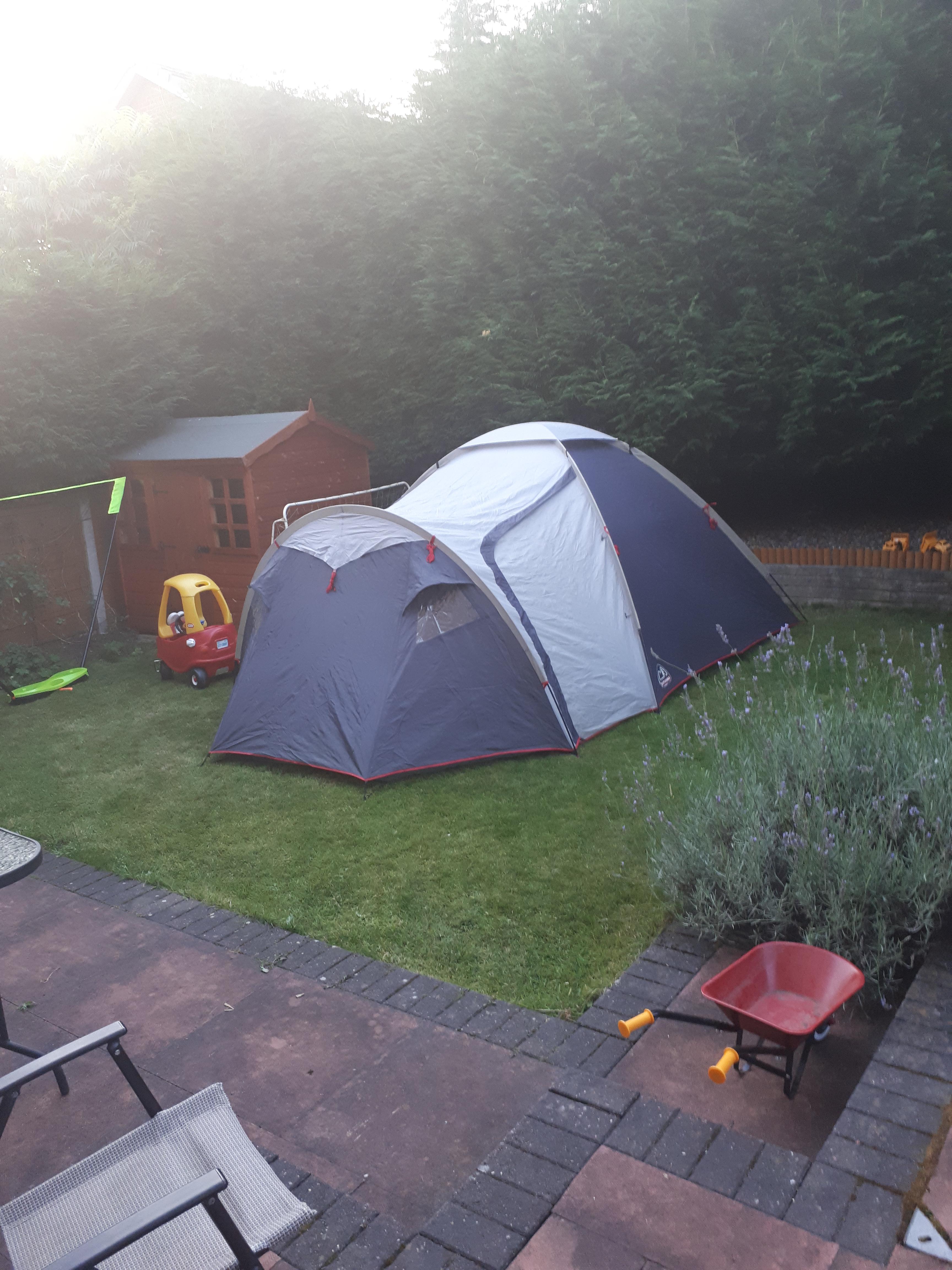 boys zipped into tent
