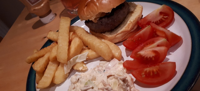 home made burger, chips, tomato and coleslaw