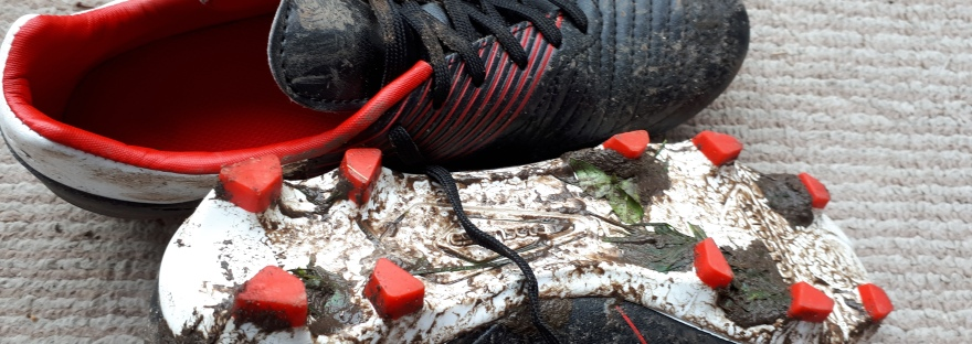 muddy rugby boots