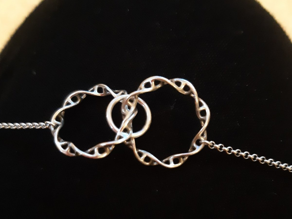 necklace with a third loop, miscarriage