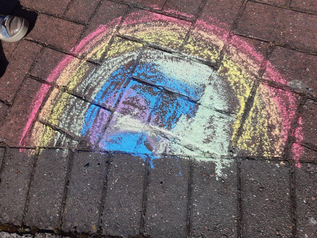 chalk rainbow on brick driveway