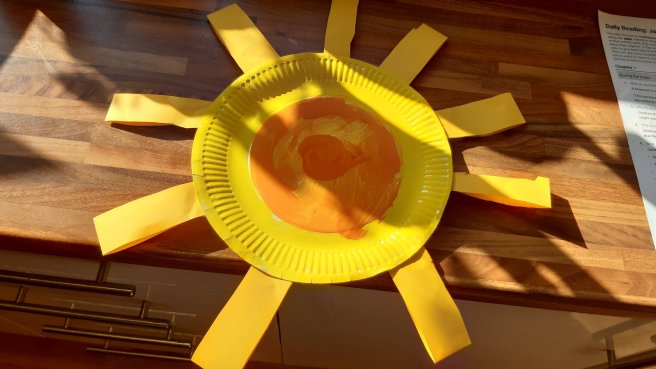 Paper plate sunshine made by small boy