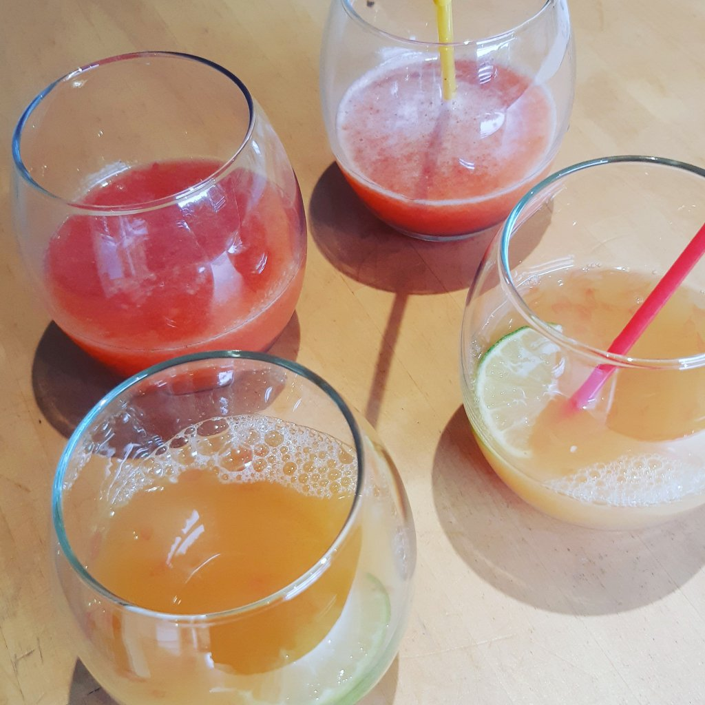 Fruit Fizz and Citrus Squeeze, four glasses of non-alcoholic cocktails