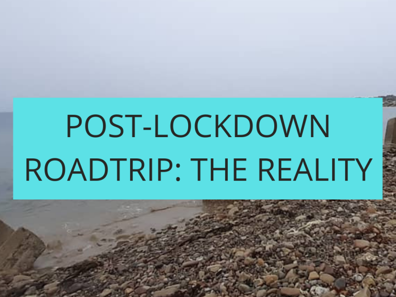 """Caption """"Post-Lockdown Roadtrip: The Reality"""" with a backdrop of a stony beach on a very wet day"""