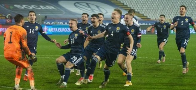 Scotland football team celebrating a win on penalties