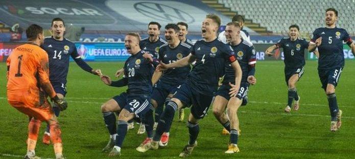 Scotland football team celebrating a win on penalties