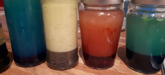 oil and coloured water in jars