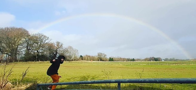 Large boy and a rainbow